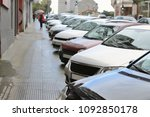 cars parked in a row on a city...   Shutterstock . vector #1092850178