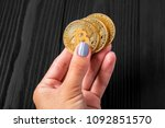 gold bitcoin in hands at the... | Shutterstock . vector #1092851570