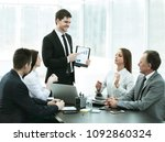 business team discussing a... | Shutterstock . vector #1092860324