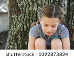little girl is lost in thought. ...   Shutterstock . vector #1092873824
