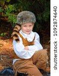 little boy  wearing a coon...   Shutterstock . vector #1092874640