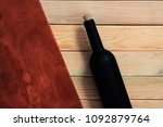 black bottle of red wine on a... | Shutterstock . vector #1092879764