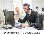 handsome man working in call... | Shutterstock . vector #1092882689