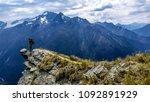 traveler standing at the edge... | Shutterstock . vector #1092891929