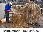 fisherman repairing fishing... | Shutterstock . vector #1092894659