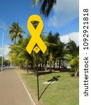 Small photo of Maceió, Alagoas/Brazil - May 11, 2018: Campaign tie-symbol May Yellow posted on post on sidewalk