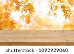 wooden table in front of... | Shutterstock . vector #1092929060