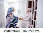 two young muslim women embrace... | Shutterstock . vector #1092934496