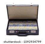 black briefcase full of money...   Shutterstock . vector #1092934799
