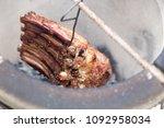 beef ribs in tandoor. grilled...   Shutterstock . vector #1092958034