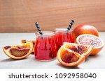 blood orange juice. red orange...   Shutterstock . vector #1092958040