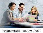 a business team of three... | Shutterstock . vector #1092958739