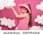 fashionable girl posing on a... | Shutterstock . vector #1092991028