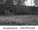 old hovel on forest edge | Shutterstock . vector #1092991460