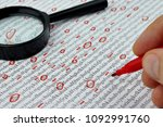 Small photo of Spy reading word data encrypt with magnifying glass. Cipher encryption code or data