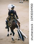 Small photo of Corrida. Matador and horse Fighting in a typical Spanish Bullfight