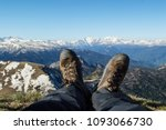 the feet of a man in boots... | Shutterstock . vector #1093066730