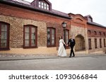 gorgeous happy wedding couple... | Shutterstock . vector #1093066844