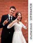 gorgeous happy wedding couple... | Shutterstock . vector #1093066928