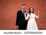 gorgeous happy wedding couple... | Shutterstock . vector #1093066934