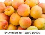 Heap ripe apricots. Natural background - stock photo