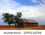 weathered old farmhouse on the... | Shutterstock . vector #1093116296