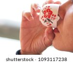 Small photo of Close-up portrait of asia woman enjoy for taking a sip of chinese tea.