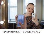 young cute woman making herself ... | Shutterstock . vector #1093149719
