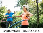 senior woman exercising with a... | Shutterstock . vector #1093154516