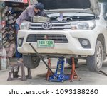 a mechanic working on a car... | Shutterstock . vector #1093188260