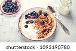 bowl of granola with yogurt and ... | Shutterstock . vector #1093190780
