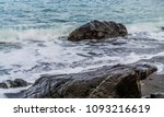 Wet Sea Stones In The Sand At...