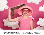 fashionable girl posing on a... | Shutterstock . vector #1093227530