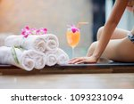 hand of woman touch glass of...   Shutterstock . vector #1093231094