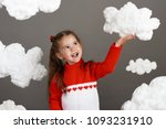 girl playing with clouds ... | Shutterstock . vector #1093231910