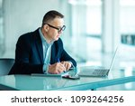 senior man in office working on ... | Shutterstock . vector #1093264256