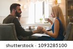 young couple having lunch in... | Shutterstock . vector #1093285100