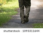 back view man's feet walking...   Shutterstock . vector #1093311644