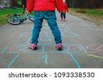 little girl play hopscotch on... | Shutterstock . vector #1093338530