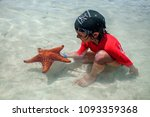 little boy with a starfish on... | Shutterstock . vector #1093359368