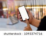 male holding phone blurred... | Shutterstock . vector #1093374716