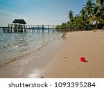 red flower on yellow sand and... | Shutterstock . vector #1093395284