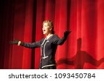 Small photo of actress acting on stage