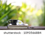 black coffee cup with flower... | Shutterstock . vector #1093566884