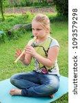 portrait of little girl playing ...   Shutterstock . vector #1093579298