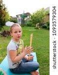 portrait of little girl playing ...   Shutterstock . vector #1093579304