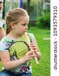 portrait of little girl playing ...   Shutterstock . vector #1093579310