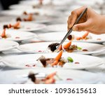 a chef decorates many plates of ... | Shutterstock . vector #1093615613