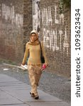 Small photo of BERLIN / GERMANY - SEPTEMBER 24th, 2003: Young unidentified woman of Turkish descent wearing a head-scarf in Kreuzberg district.
