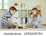 two little children playing... | Shutterstock . vector #1093650794
